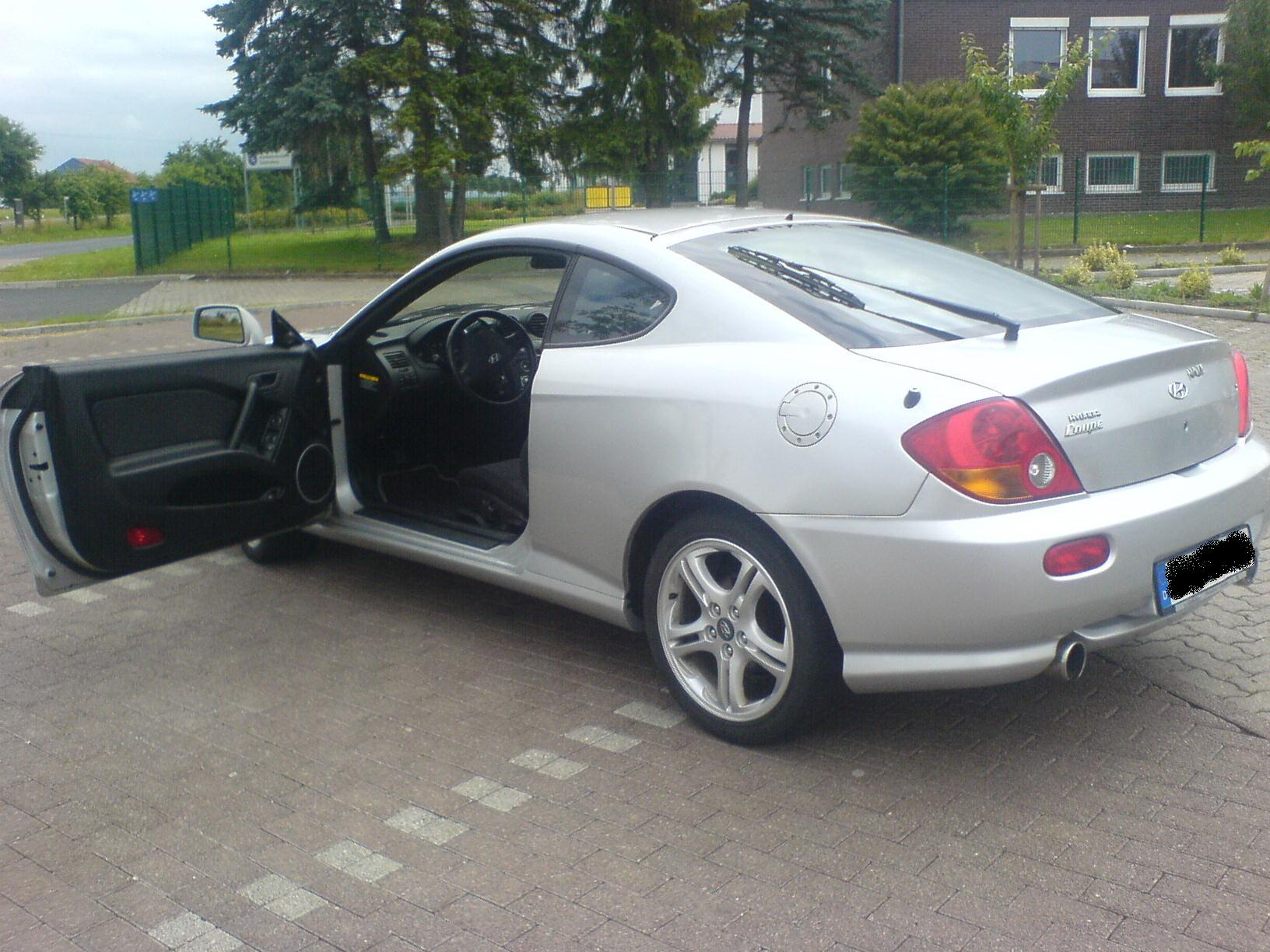 hyundai coupe 2 0 gls photos and comments. Black Bedroom Furniture Sets. Home Design Ideas