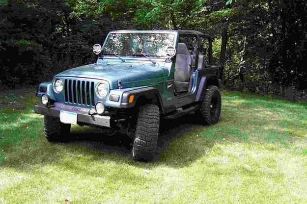jeep wrangler 4 0 sport photos and comments. Black Bedroom Furniture Sets. Home Design Ideas
