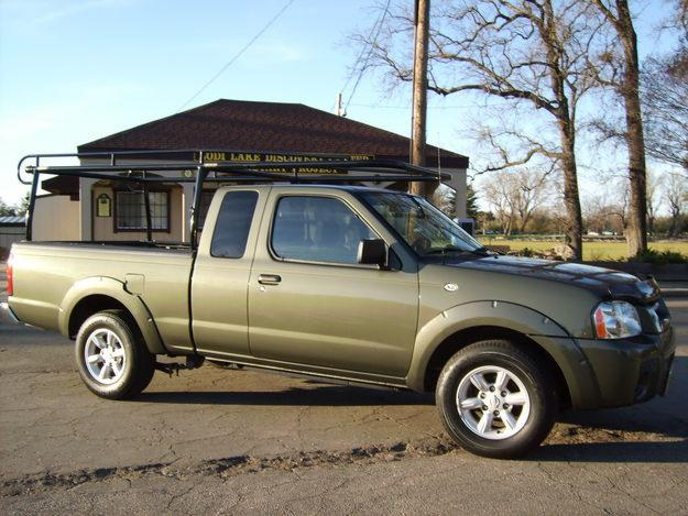 nissan frontier king cab xe photos and comments. Black Bedroom Furniture Sets. Home Design Ideas