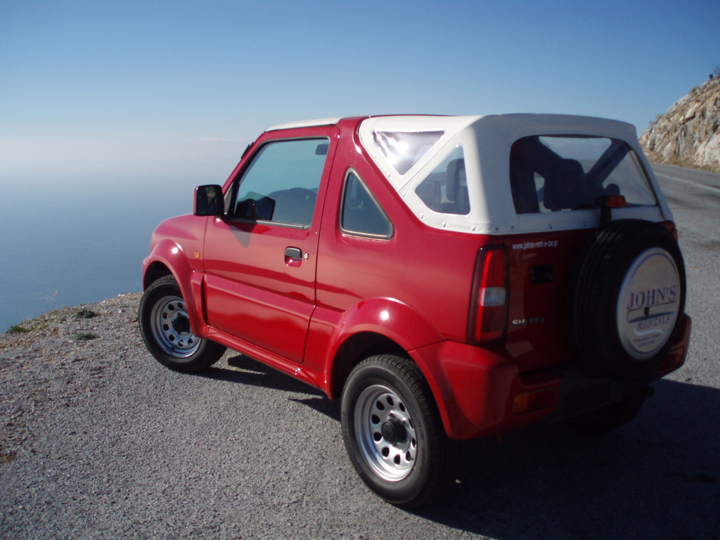 suzuki jimny 1 3 cabrio photos and comments. Black Bedroom Furniture Sets. Home Design Ideas